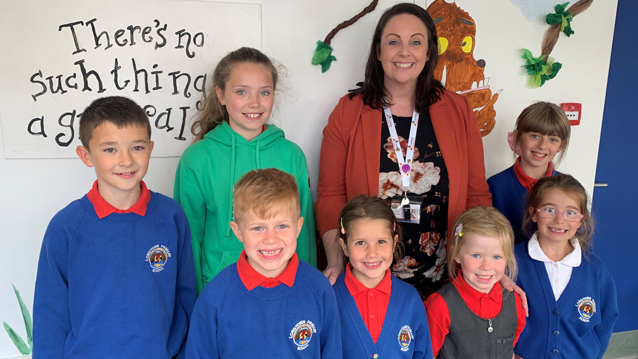 Headteacher Cate Floyd and students from Longtown Primary School